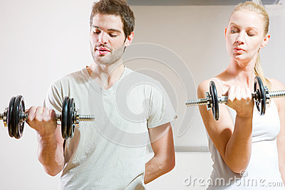 Man and woman lifting dumbbell