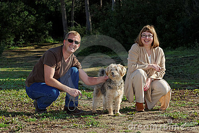 Man and Woman with Little Dog. stock photo