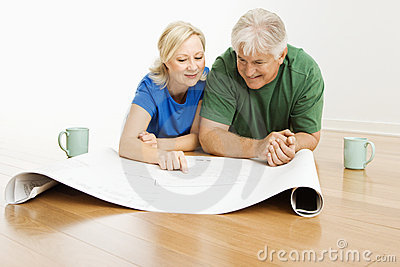 Man and woman looking at blueprints.
