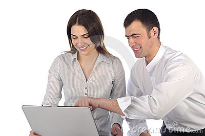 Man and woman looking at laptop and laughing