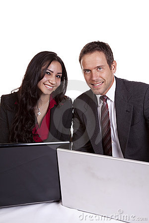 Man and woman looking over laptops