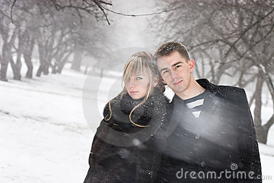 Man and woman in love in blizzard