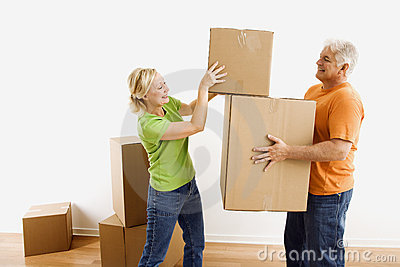 Man and woman moving boxes.