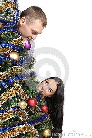Man and woman near Christmas Tr