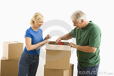 Man and woman packing.