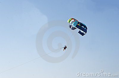 Man woman paragliding blue sky India
