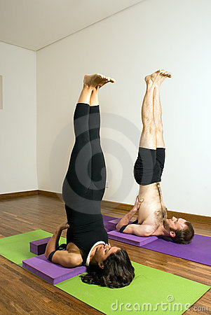 Man and Woman Performing Yoga - Vertical