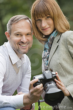 Man and woman with photo camera