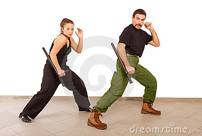 Man and woman practce with truncheon