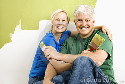 Man and woman relaxing while painting.