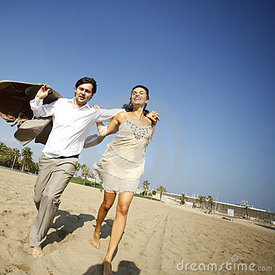 Man and woman running on beach