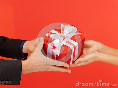 Man and woman s hands with gift box