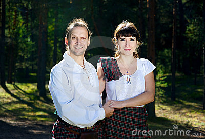 Man and woman in scottish costume