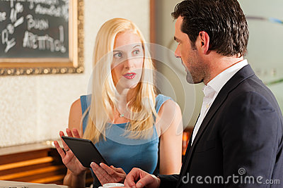 Man and a woman sitting in cafe