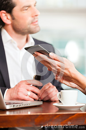 A man and a woman - sitting in cafe