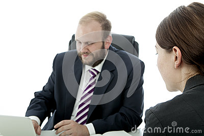 Man And Woman Sitting At Desk Royalty Free Stock Image - Image: 26244036