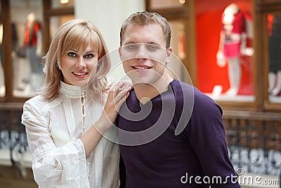 Man and woman smiling looking at camera