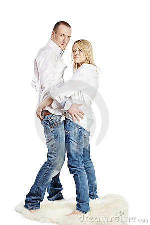 Man and woman stand embraced