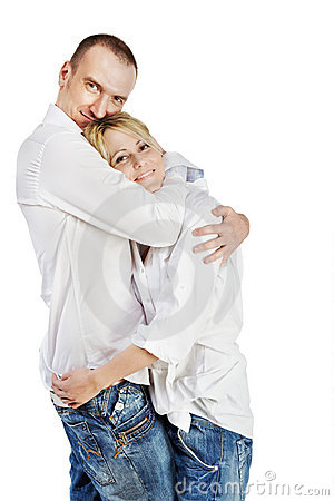Man and woman stand hugging Stock Photo