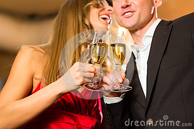 Man and woman tasting Champagne in restaurant