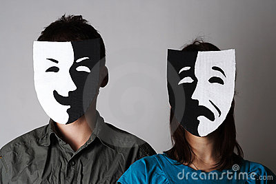 Man and woman in theatre emotions masks