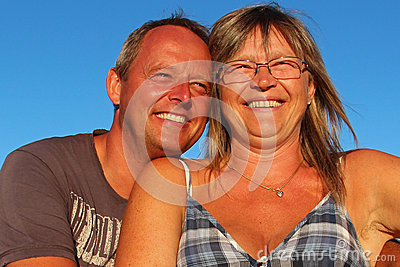 A man and a woman laughing