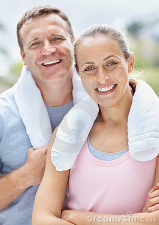 Man and woman with towel around their necks