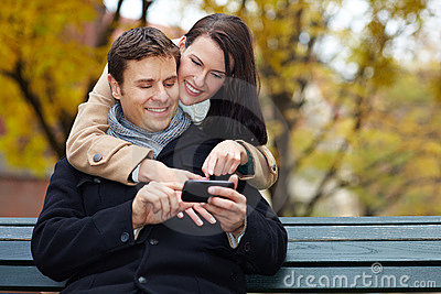 Man and woman using smartphone