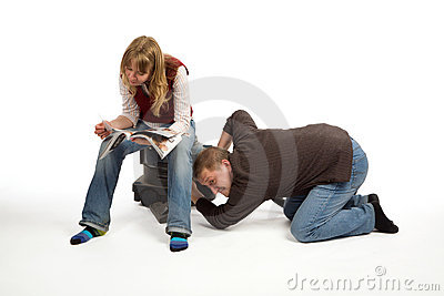Man and woman with vacuum cleaner