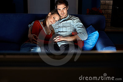 Man and woman watching movie on tv