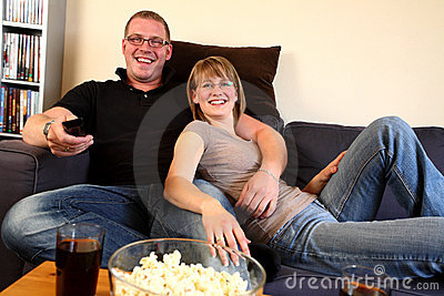 Man and Woman Watching TV at Home