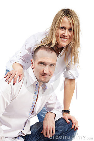 Man and woman in white shirts and blue jeans Stock Photo