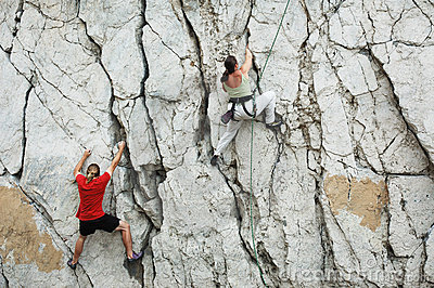 Man and women climbing