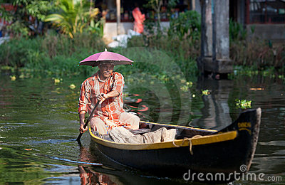 Man in the wooden boat in kerala backwaters Editorial Stock Photo