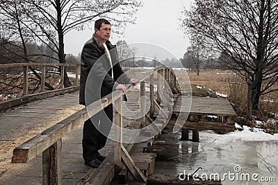 Man on wooden bridge Editorial Image