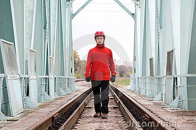 Man worker blindly in a helmet stands on the rails