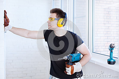 Man worker with drill