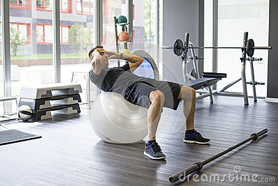 Man working abs in gym