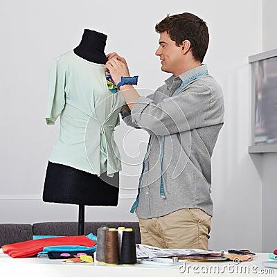 Man working on dress form