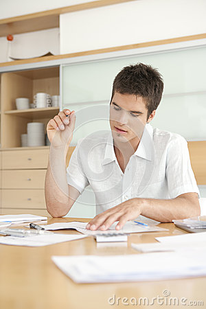 Man Working on Finances
