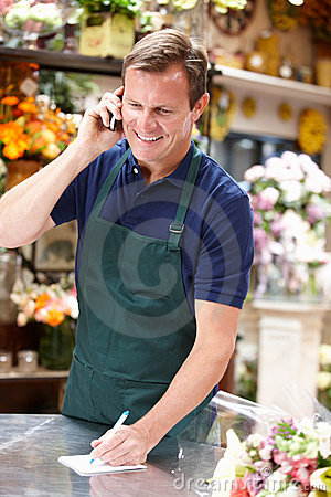 Man working in florist standing at counter