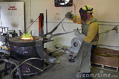 Man Working in the Foundry Hot Furnace