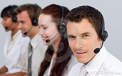 Man working with his team in a call center