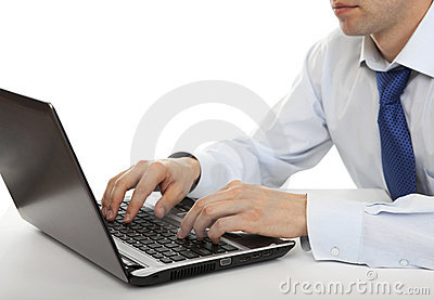 Man working on a laptop.
