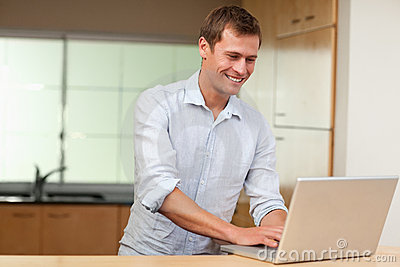 Man working on laptop in the kitchen