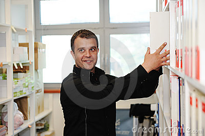 Man working at office putting folders