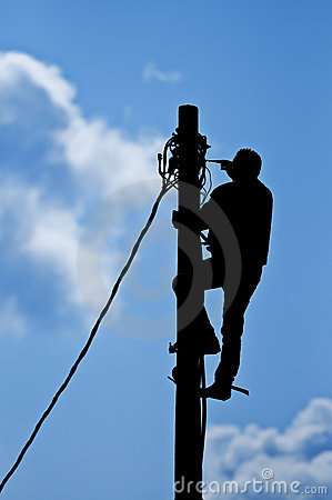 Free Man Working On Pole Stock Photo - 13542320