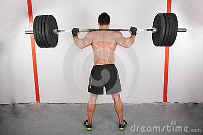 Man working out with a bar