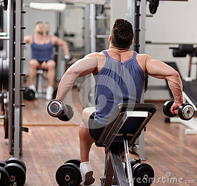 Man working out in front of the mirror