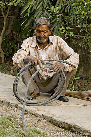 Man working with a pipe